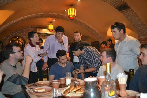 The Armenian PCVs and the local Armenians converse about how awesome Armenia is at dinner